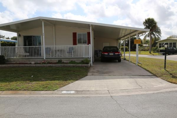 mhvillage home with porch and carport ez homes
