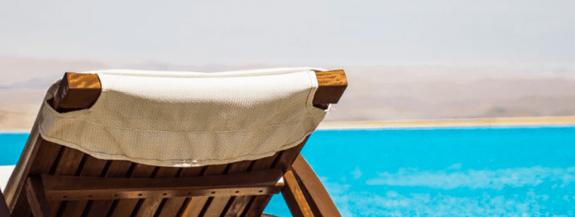 Relaxing chair by beach