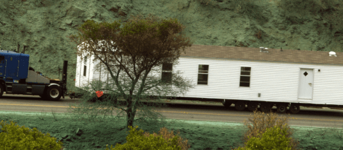 Mobile Home being transported up a hill