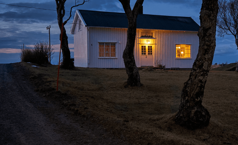 Farm house sitting on big piece of land in the evening
