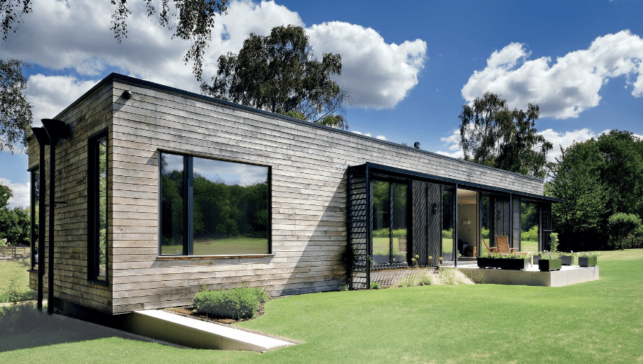 A modern mobile home with wood and steel
