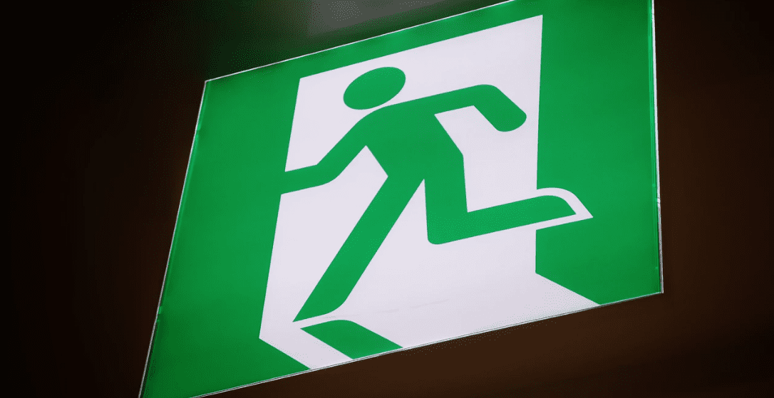 Exit signage, green and white