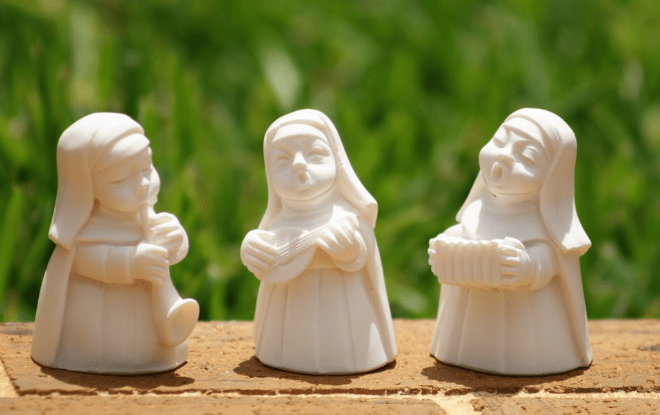 Nun figurines playing music instruments