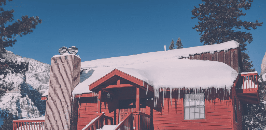 Snow on a red house roof