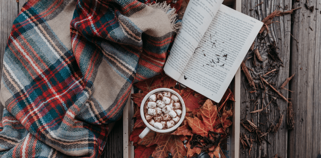 Fall activity with hot cocoa and a book and blanket
