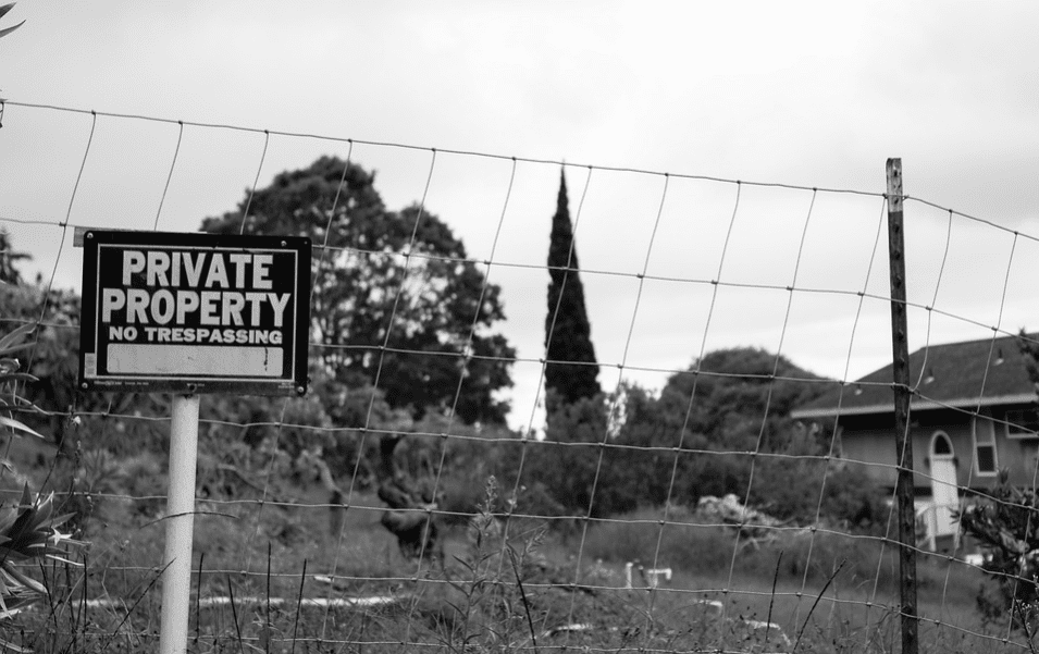 Fence with a private property sign