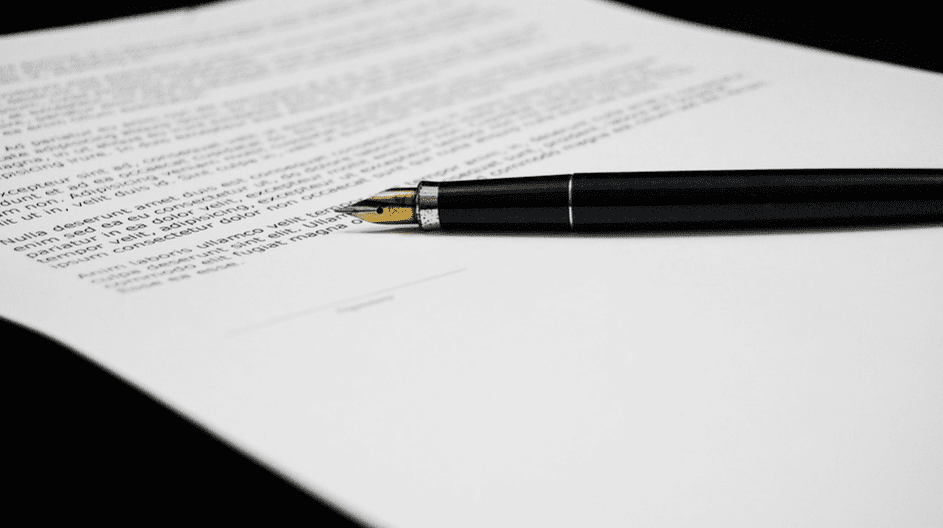 A fountain pen laying on top of a document