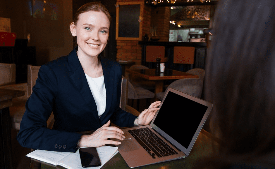 A business woman with her laptop and mobile phone