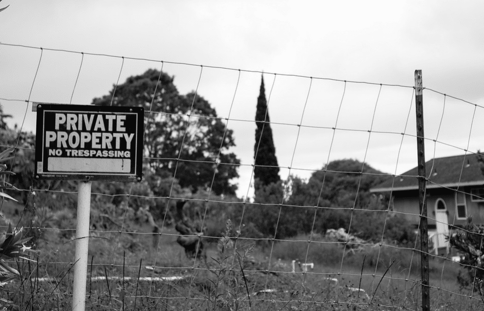 Private property sign within fence of a home