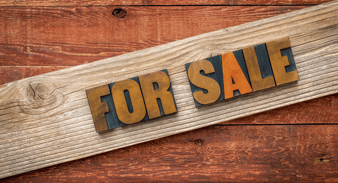 For Sale sign on wood