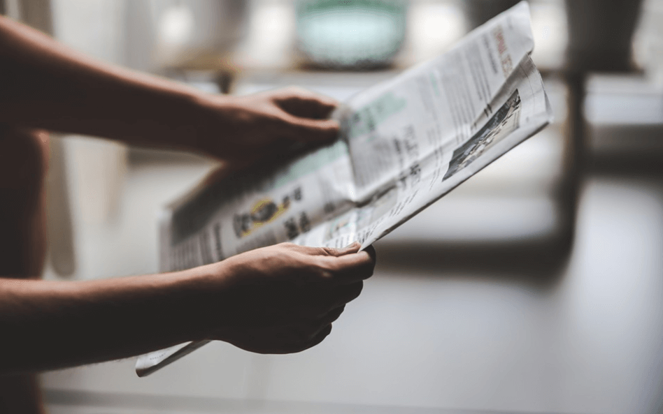 A man holding a newspaper