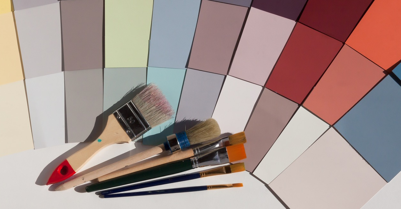 Paint  brushes with a collection of color swatches