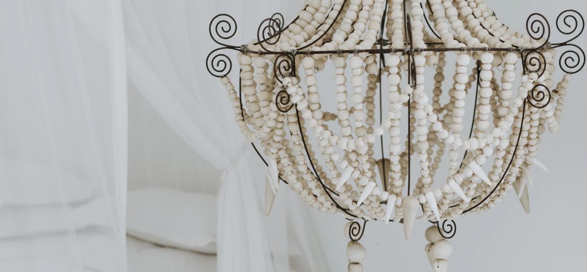 Ornate chandelier with beads in a bedroom
