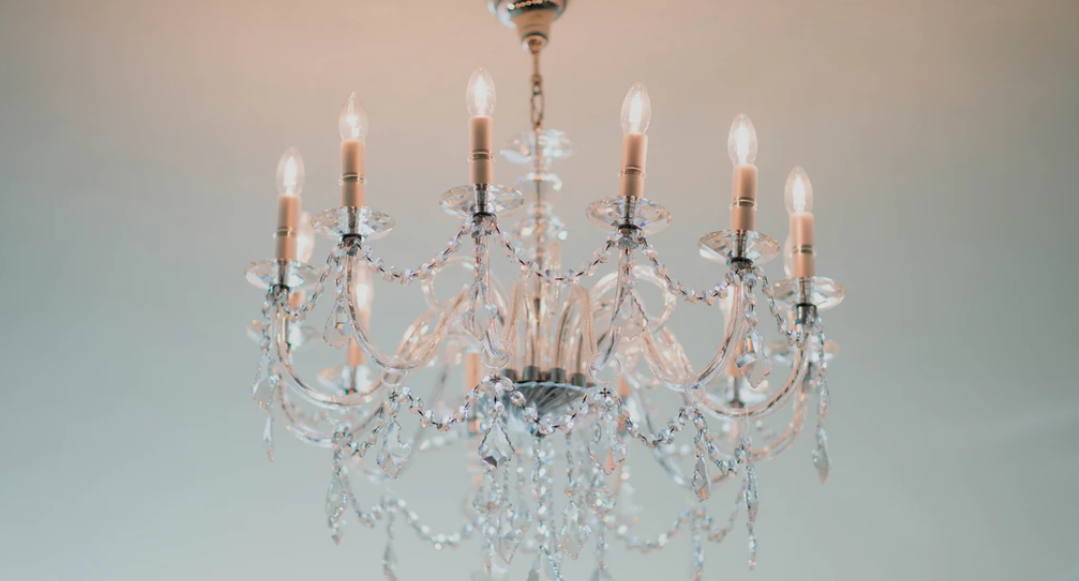 Simple but elegant chandelier suspended from ceiling
