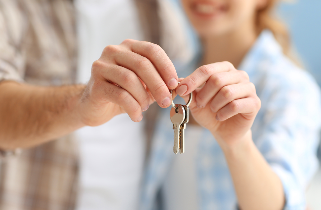 First time home buyers, couple with house keys