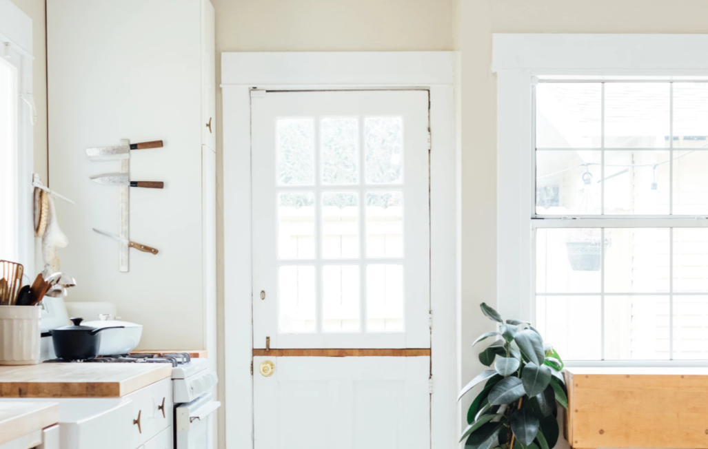 White Dutch Door Leading To Kitchen