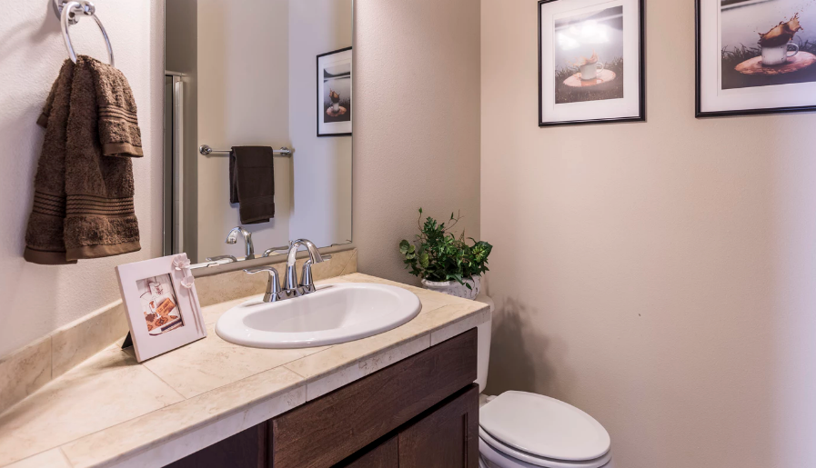 Clean bathroom with pictures on the wall