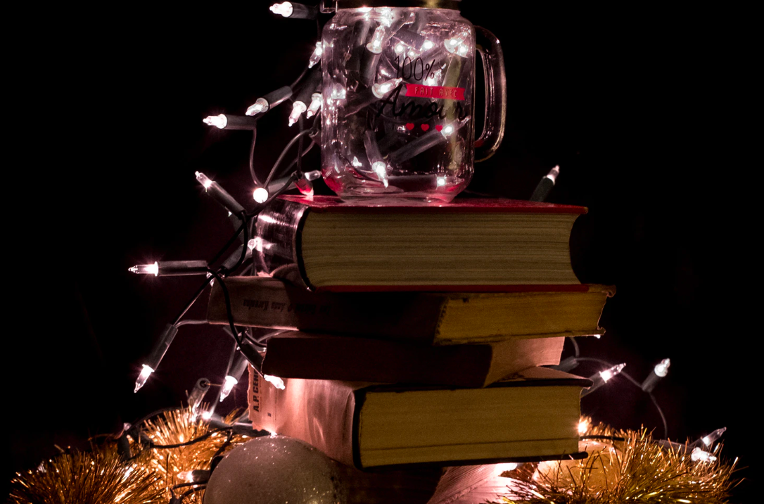 Christmas lights strung on books