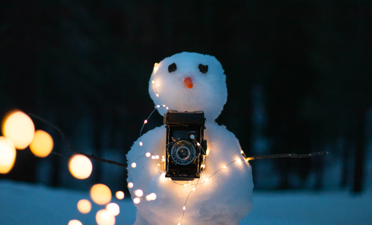 Snowman with lights and camera