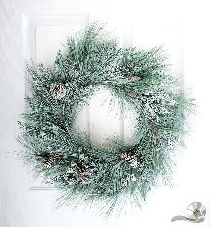 Snow sprayed frosted wreath