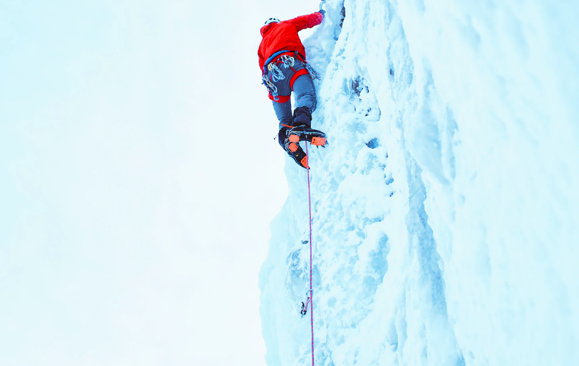 Person climbing with ice picks