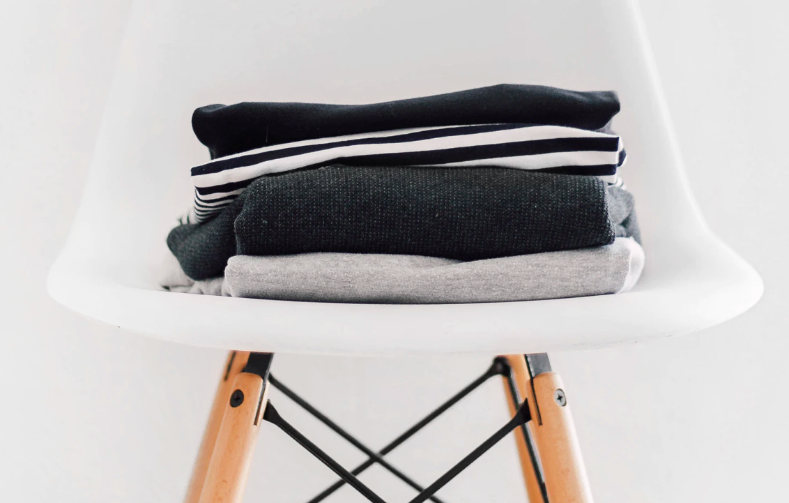 Clothes folded on a chair