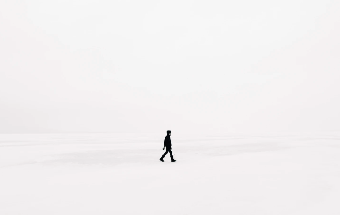 Man in black with white background