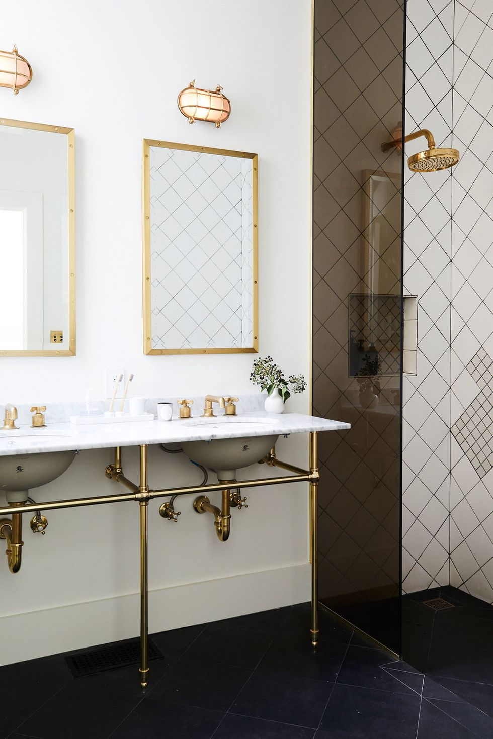 Black and white bathroom, brass accents