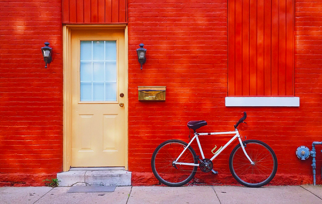 Yellow door of a red painted brick building