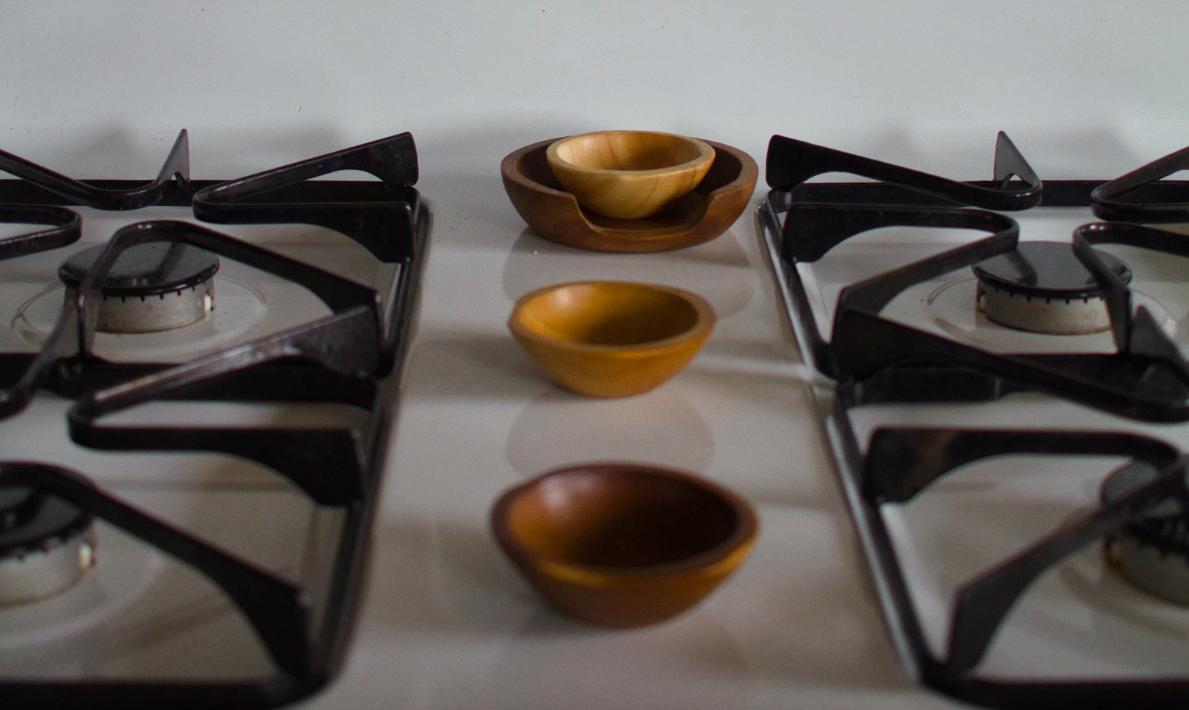 Wooden bowls on gas stove