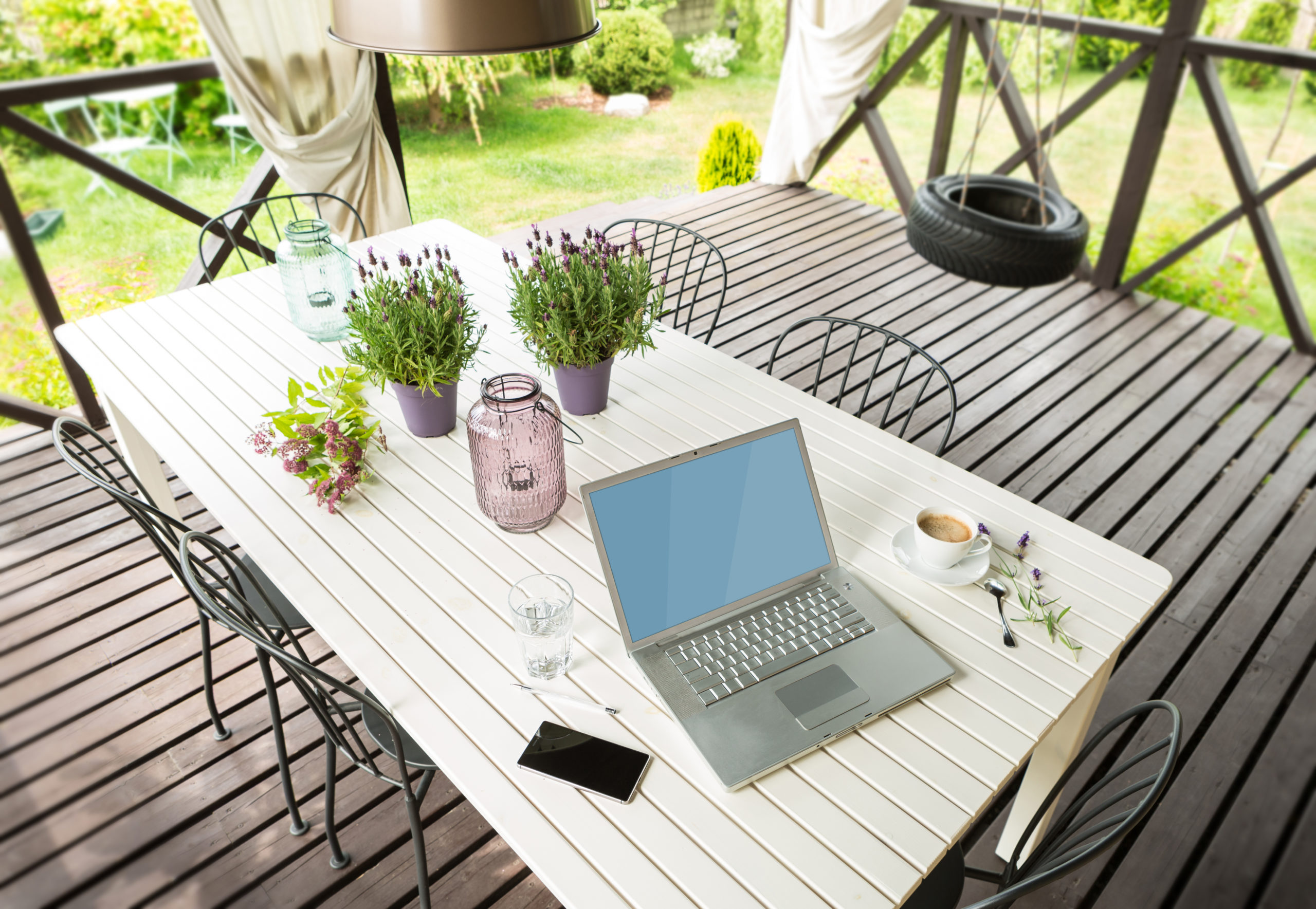 Laptop computer and mobile phone (smartphone) on a porch