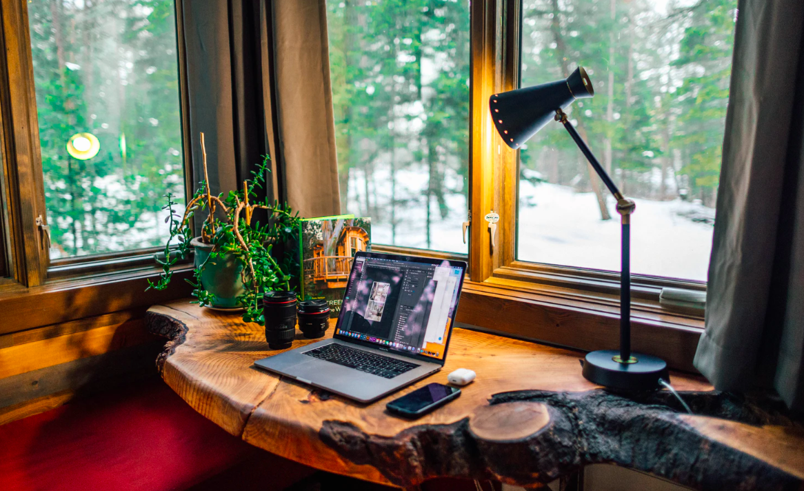 Desk with lamp by the window