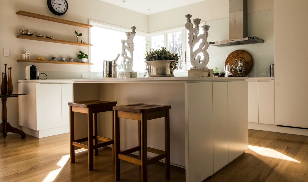 Kitchen island with wooden bar stools