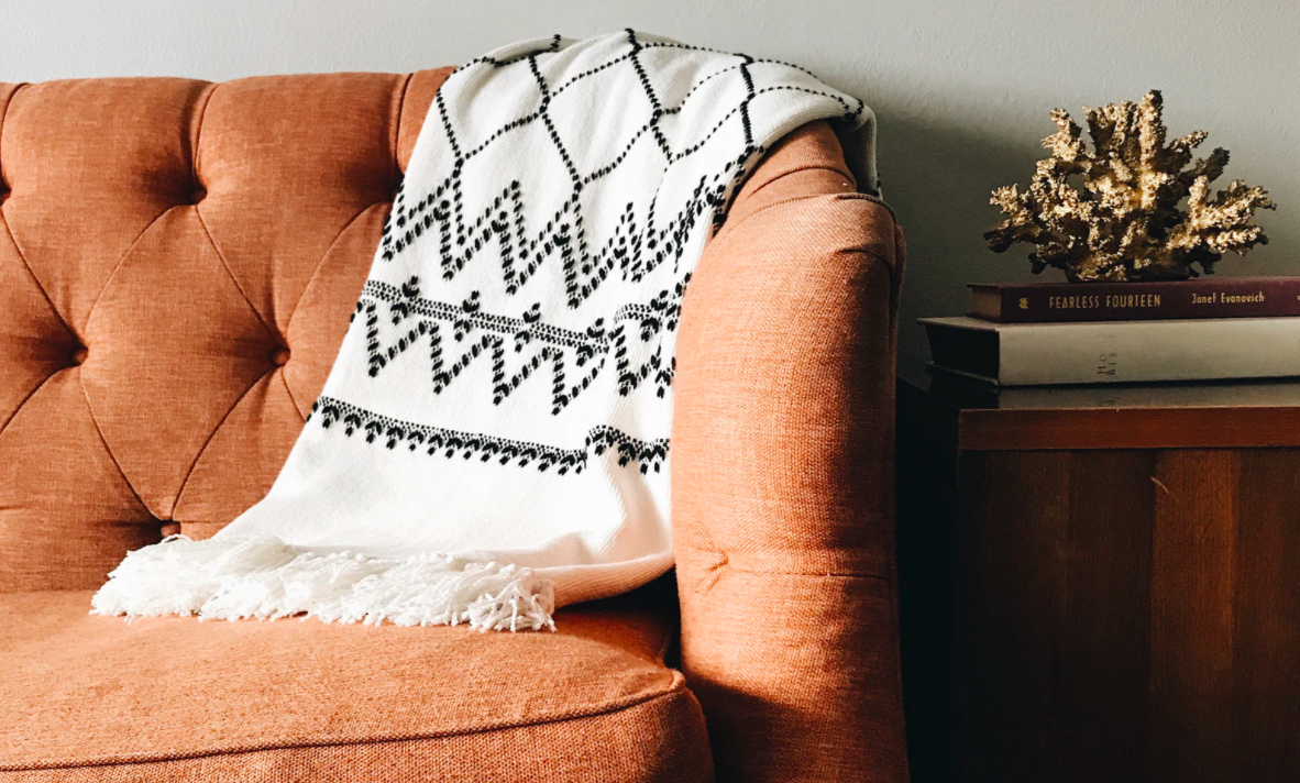 Traditional couch with patterned blanket