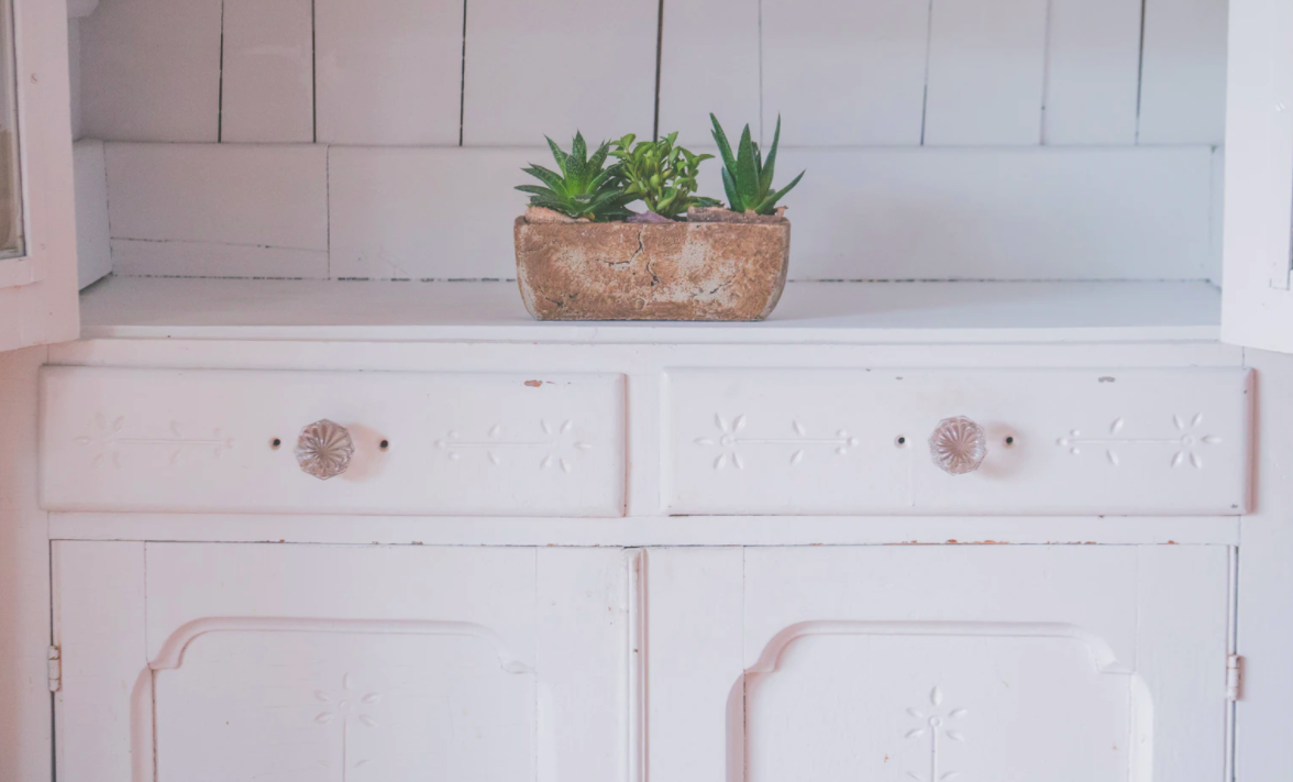White cabinet with knobs
