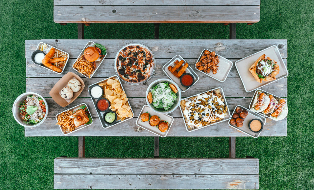 Assortment of food on outdoor table