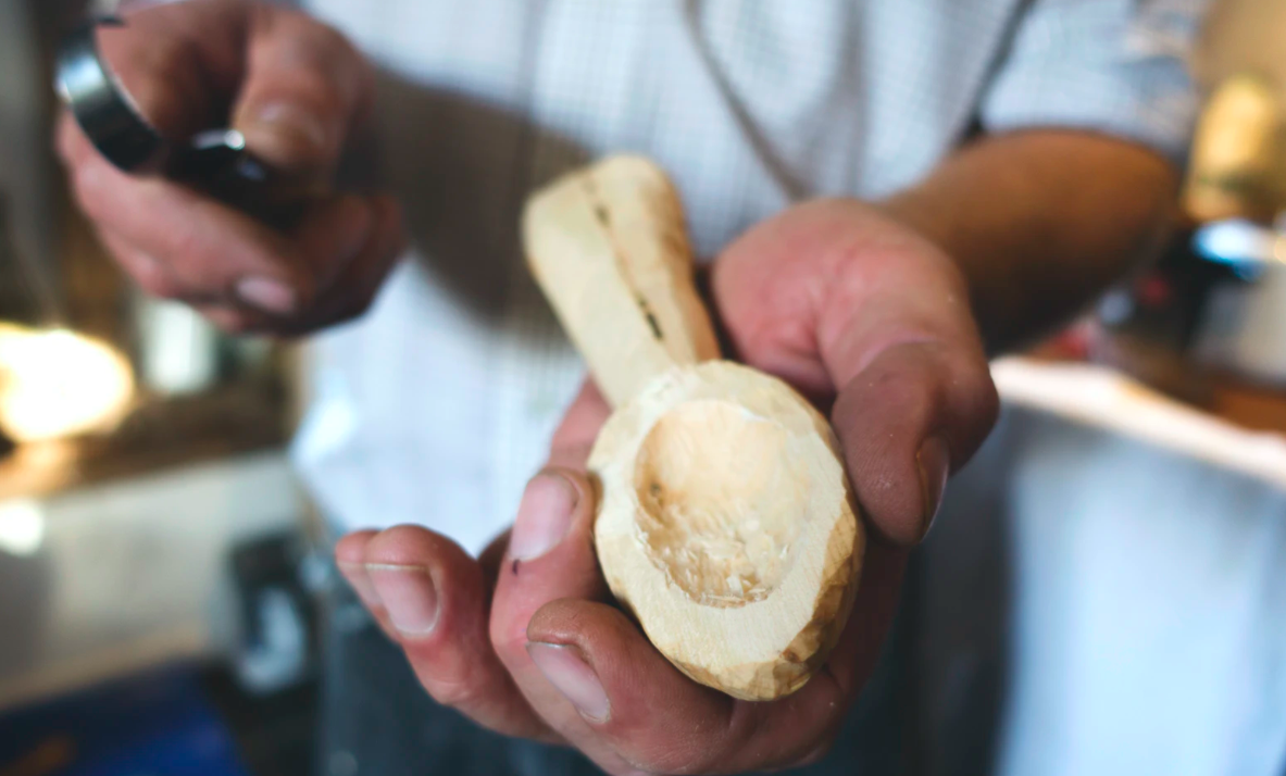 Man carving a spoon