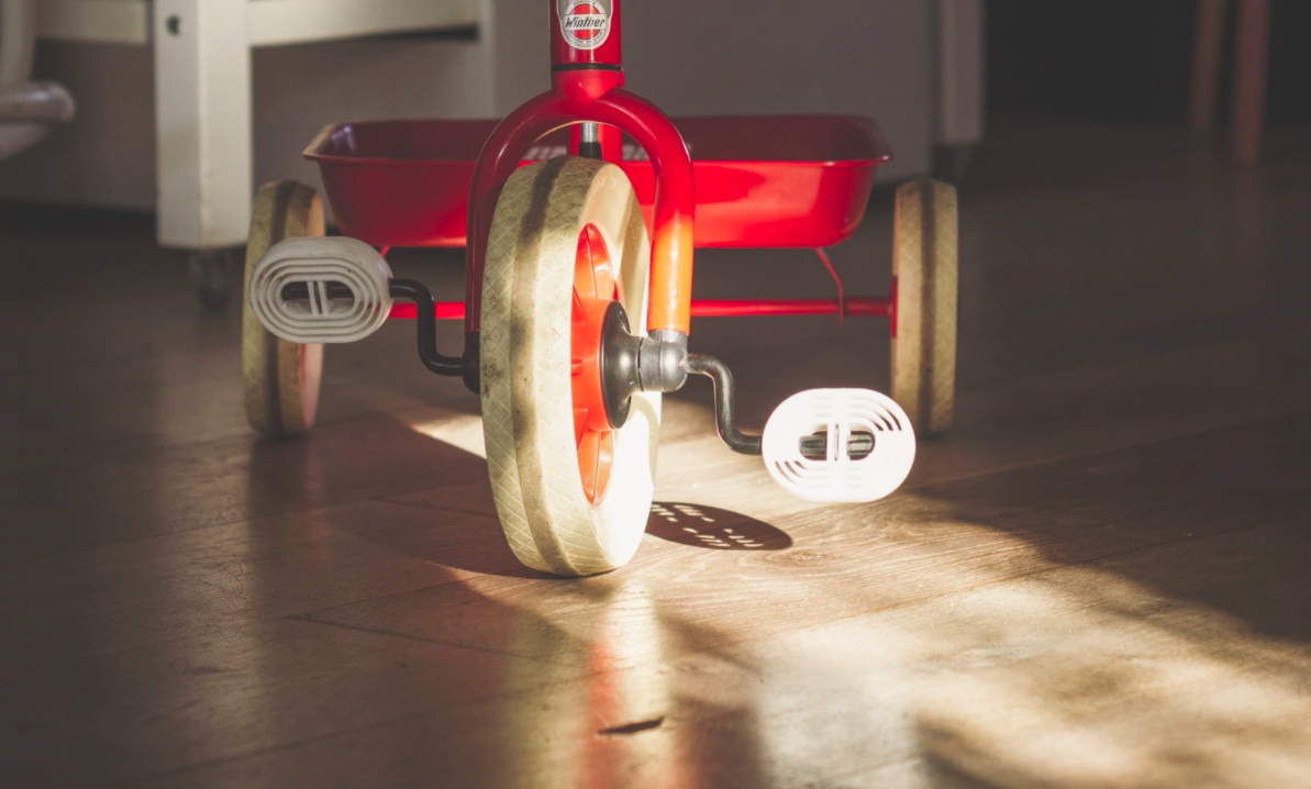Child's tricycle on wooden floor