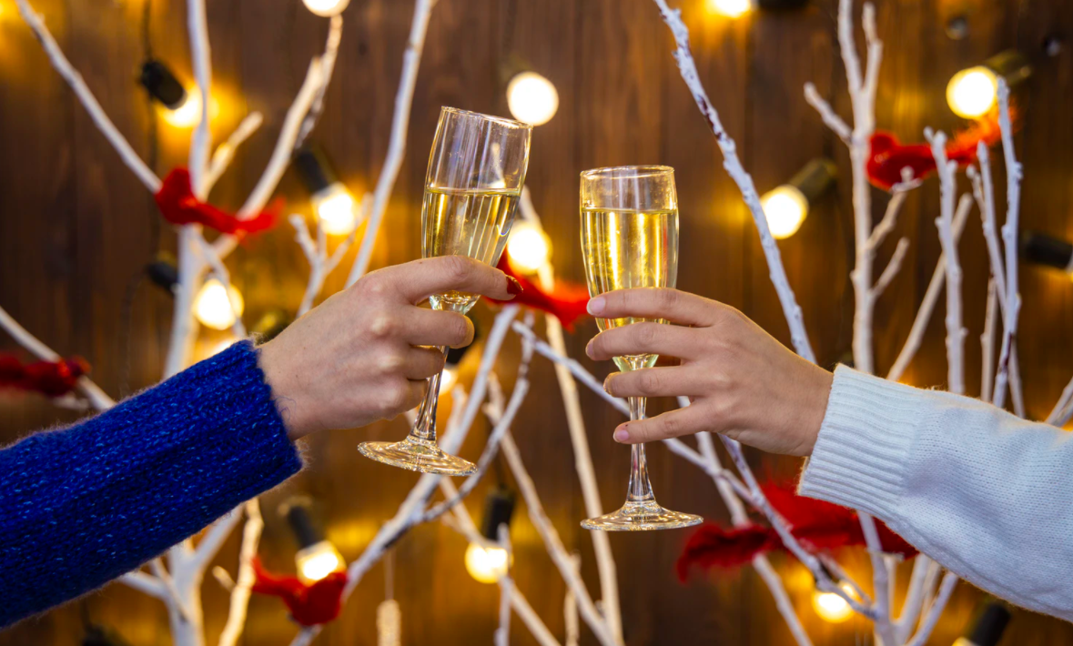 Champagne glasses with festive background
