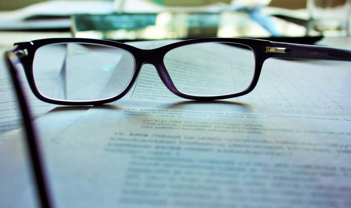 A pair of glasses on a document