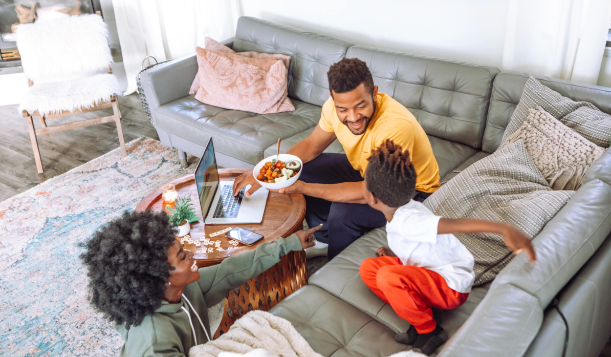 Family sitting together in a living room