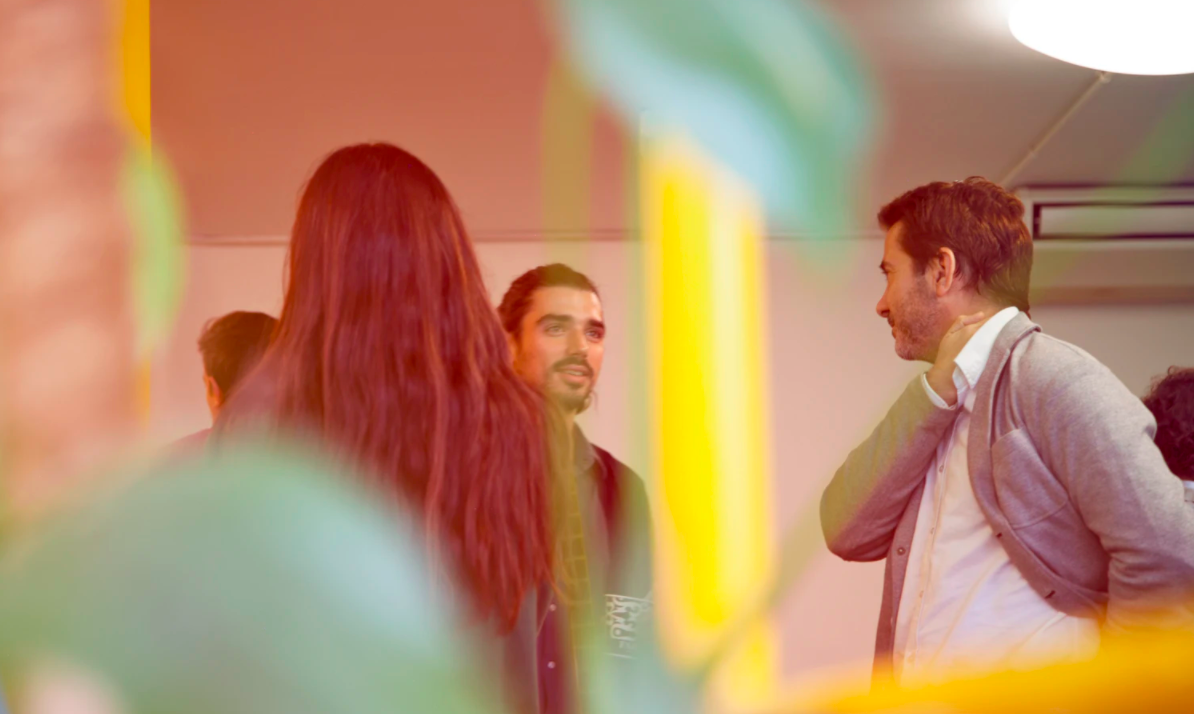 Group of people talking to each other