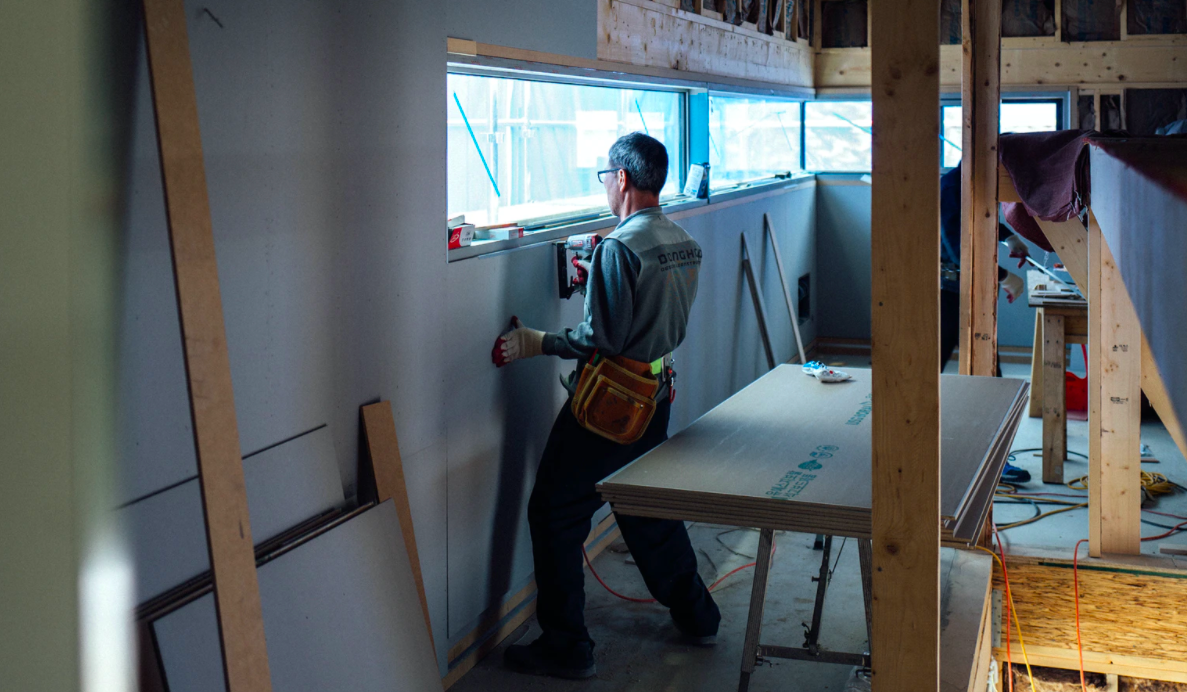 Man working on home walls indoors